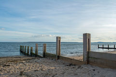 Wooden Sea Defences Protecting a Sandy Beach in Scotland. Woodens sea defences prtecting the beach in Monifieth, Scotland, from erosion Royalty Free Stock Images