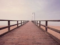 Free Wooden Sea Pier At Misty Morning With Light Posts. Heavy Mist Royalty Free Stock Photo - 111879895