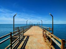 Wooden sea pier overlooking the sea royalty free stock image