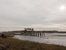 wooden sea structure moody overcast grey sky river estuary royalty free stock photography
