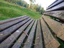 Wooden seat. A wooden seat/bench commonly seen in a park Royalty Free Stock Photos