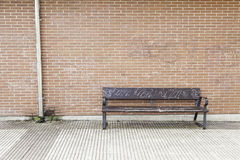 Wooden seat in the city Stock Image