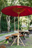 Wooden seat and pavilion in the garden Royalty Free Stock Photography