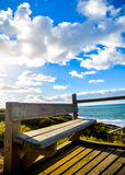 Wooden seat with Sea and blue sky1. Wooden seat with Sea and blue sky Stock Image