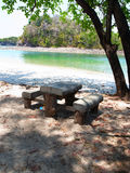 Wooden seats on beach Royalty Free Stock Images