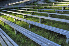 Wooden seats at stadium Royalty Free Stock Photos
