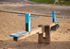Wooden see-saw. Old wooden see saw at the playground Royalty Free Stock Photo