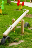 Wooden see-saw. On the playground Royalty Free Stock Photo