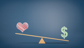 A wooden seesaw on blue chalkboard background with a drawn USD sign overweighing a heart sign Stock Images