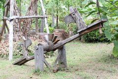 Wooden seesaw. Made from cart wheels Stock Photos