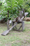 Wooden seesaw. Made from cart wheels Royalty Free Stock Image