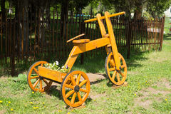 Wooden self-made bicycle. Art object in the park Royalty Free Stock Photos