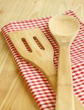 Wooden serving spoons on checkered napkin Royalty Free Stock Photography