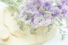 Wooden set of food utensil and static flower Royalty Free Stock Images