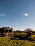 Wooden Shack. A wooden shack in a rural area with a clear blue sky Royalty Free Stock Photography