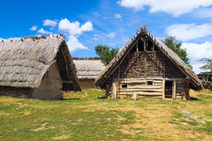 Wooden shack with thatched roofs in rural. Open-air farmer Stock Photos