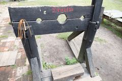 Wooden shackles to torture prisoners in the Middle Ages. Device for flogging. Place - open-air museum, abase, abuse, antique, block, board, castle, dungeon stock image