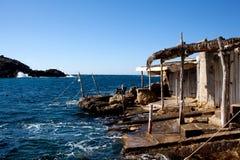 Wooden shacks on rocky coast Royalty Free Stock Image