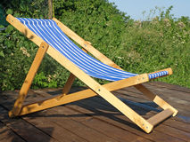 Wooden shaise lounge. Wooden shaise lounge on nature Stock Images