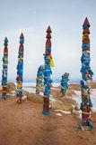 Wooden shaman totems with ribbons Stock Photography