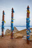 Wooden shaman totems with ribbons Stock Photos