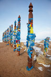 Wooden shaman totems with ribbons Royalty Free Stock Photos
