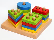 Wooden shape sorter. A Colourful wooden shape sorter toy as educational instrument for young children royalty free stock images