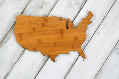 Wooden shape of USA on rustic white boards Stock Photos