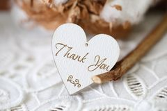 Wooden shaped heart with written word thank you on it royalty free stock image