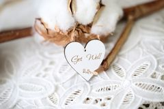 Wooden shaped heart with written words Dream Big on it, vintage font royalty free stock images