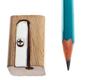 Wooden sharpener and pencil. Nice wooden sharpener and green pencil on white isolated background Stock Image