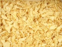 Wooden shavings background. Wooden chips texture background. Bright yellow Royalty Free Stock Image
