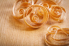 Wooden shavings on board Royalty Free Stock Photos