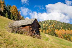 Wooden Shed in the Alps and Blue Sky Stock Photo