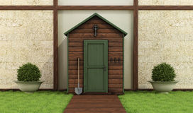 Wooden shed in a classic garden Stock Photo