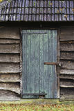 Wooden shed door. An old shed door with a rusty hinge Stock Photography