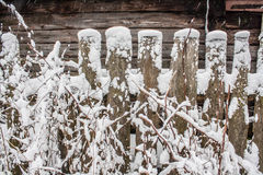 Wooden shed with fence under snow drift Royalty Free Stock Photo