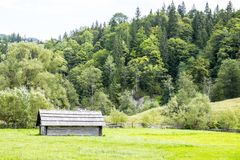 Wooden shed on a fenced plot Royalty Free Stock Photos