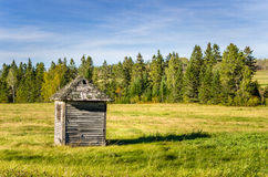 Wooden Shed in a Field and Cloudy Sky Royalty Free Stock Photography