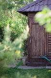 Wooden shed house in sunny green garden Stock Photography