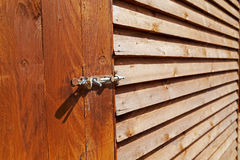 Wooden Shed and Lock Closeup. Details of Exterior Royalty Free Stock Photo