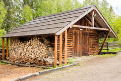Wooden shed and logs Stock Images