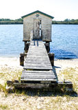 Wooden shed by a river Royalty Free Stock Image