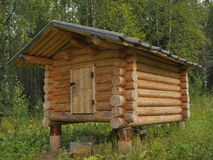 Wooden shed at taiga forest Stock Photography