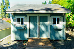 Wooden shed with white trim Royalty Free Stock Photo