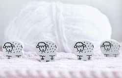 Wooden sheep and a roll of wool Royalty Free Stock Photos