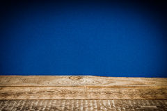 Wooden shelf and blue wall Stock Image