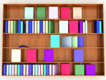 Wooden shelf with books of different colors Stock Photos