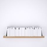 Wooden shelf with books on white wall background Royalty Free Stock Images