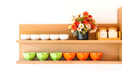 Wooden shelf with cup of coffee Royalty Free Stock Photography